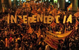 "TO GO WITH AFP STORY by Daniel BOSQUE (FILES) A picture taken on September 11, 2012 shows supporters of independence for Catalonia demonstrating in Barcelona to mark the Spanish region's official day or ""Diada"", amid growing protests over Spain's financial crisis which has driven it to seek aid from the central government. Demonstrations in favour of independence have brought hundreds of thousands of people onto the streets in recent years. Now the anti-separatists have started to mobilise too. A new movement, the Catalan Civil Society (SCC), has gained 16,000 signatures of support for staying part of Spain.   AFP PHOTO/ LLUIS GENE"